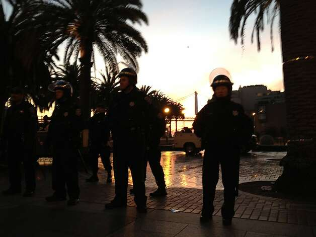 San Francisco police gather at Justin Herman Plaza after a predawn raid to tear down the camp. Seventy protesters were arrested. Photo: Will Kane, The Chronicle