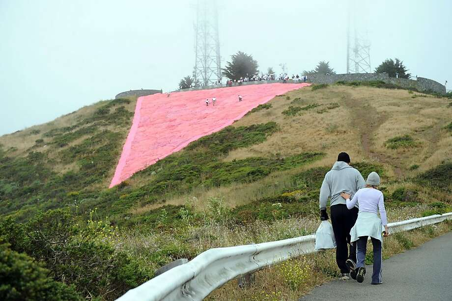 A huge pink triangle is set up at the top of Twin Peaks on Saturday. The pink triangle was used by the Nazis in concentration camps to identify and shame homosexuals. It has since been embraced by the gay community as a symbol of pride. Photo: Susana Bates, Special To The Chronicle