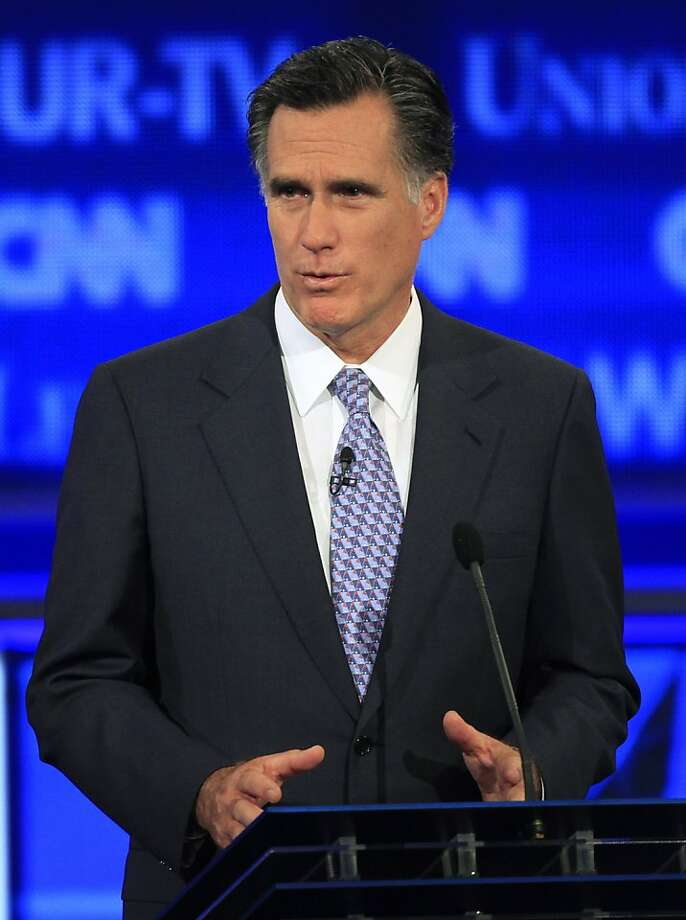 Former Massachusetts Gov. Mitt Romney answers a question during the first New Hampshire Republican presidential debate at St. Anselm College in Manchester, N.H., Monday, June 13, 2011. Photo: Jim Cole, AP