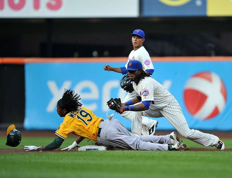 Oakland Athletics second baseman Jemile Weeks (19) slides under the tag of New York Mets shortstop Jose Reyes (7) on a stolen base attempt in the top of the first inning at Citi Field in New York Tuesday, June 21, 2011. (Christopher Pasatieri/Newsday/MCT) Photo: Christopher Pasatieri, MCT