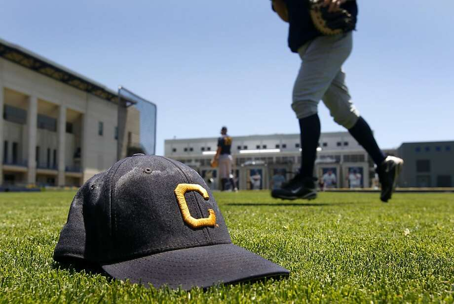 A well-worn ballcap sits on the turf while the Cal Bears baseball team takes batting practice at Evans Diamond to prepare for the College World Series in Berkeley, Calif. on Tuesday, June 14, 2011. Photo: Paul Chinn, The Chronicle