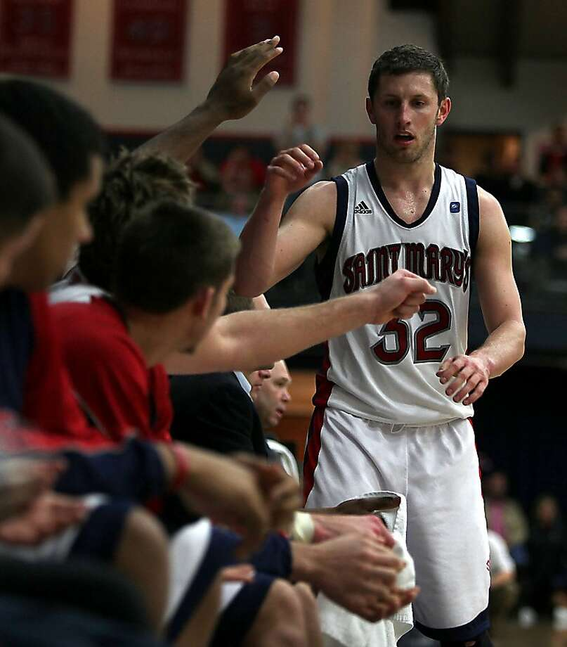 Saint Mary's College vs. Weber State in the NCCA tournament  in Moraga, Calif., as Saint Mary's Mickey McConnell high fives his teammates as Gaels lead more than 20 points during the second period on Friday, March 11, 2011. Photo: Liz Hafalia, The Chronicle