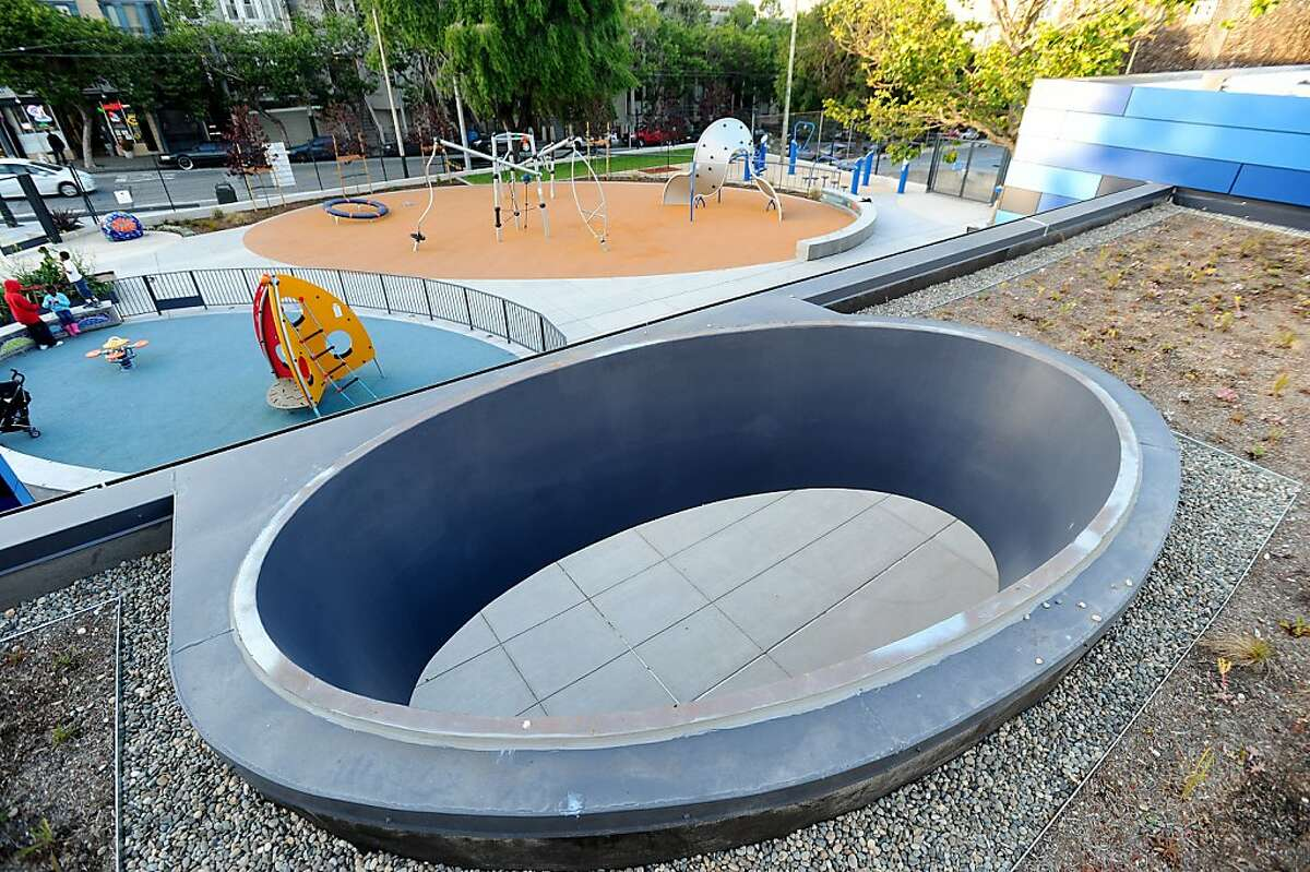 At the newly renovated Hayes Valley Playground, a circular cutout in the clubhouse's living roof echoes playground patterns on Thursday, June 16, 2011, in San Francisco.
