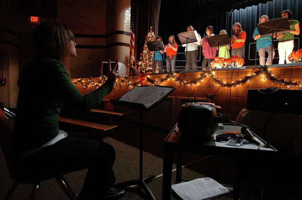 Groves Elementary's Alisa Bell conducts a Christmas program at the school on Monday. Some Southeast Texas schools are removing similar programs from holiday activities. Photo taken Tuesday, December 6, 2011 Guiseppe Barranco/The Enterprise