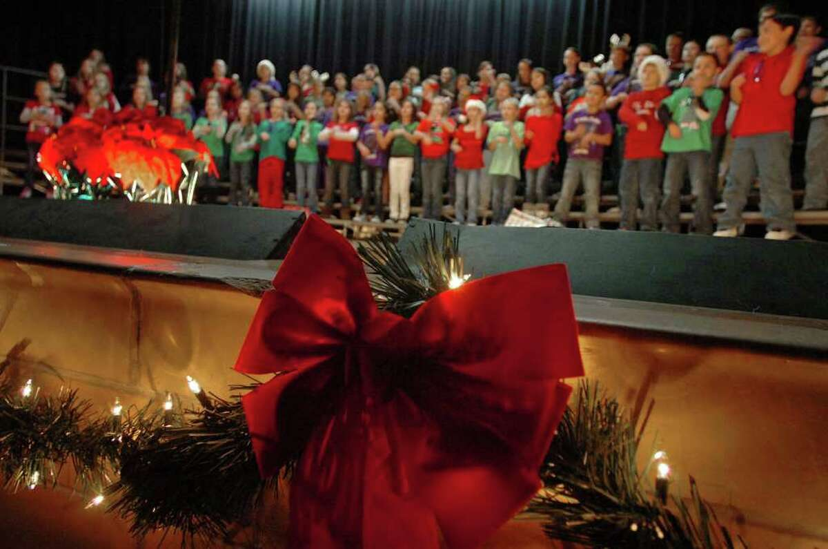Groves Elementary's students sing in a Christmas program at the school on Monday. Some Southeast Texas schools are removing similar programs from holiday activities. Photo taken Tuesday, December 6, 2011 Guiseppe Barranco/The Enterprise