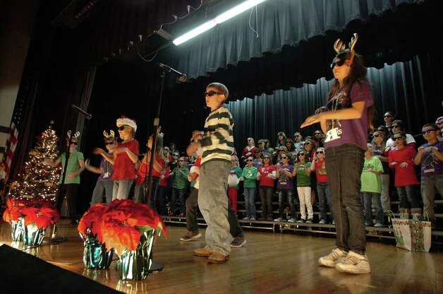 Groves Elementary's students sing in a Christmas program at the school on Monday. Some Southeast Texas schools are removing similar programs from holiday activities.  Photo taken Tuesday, December 6, 2011 Guiseppe Barranco/The Enterprise Photo: Guiseppe Barranco, STAFF PHOTOGRAPHER / The Beaumont Enterprise