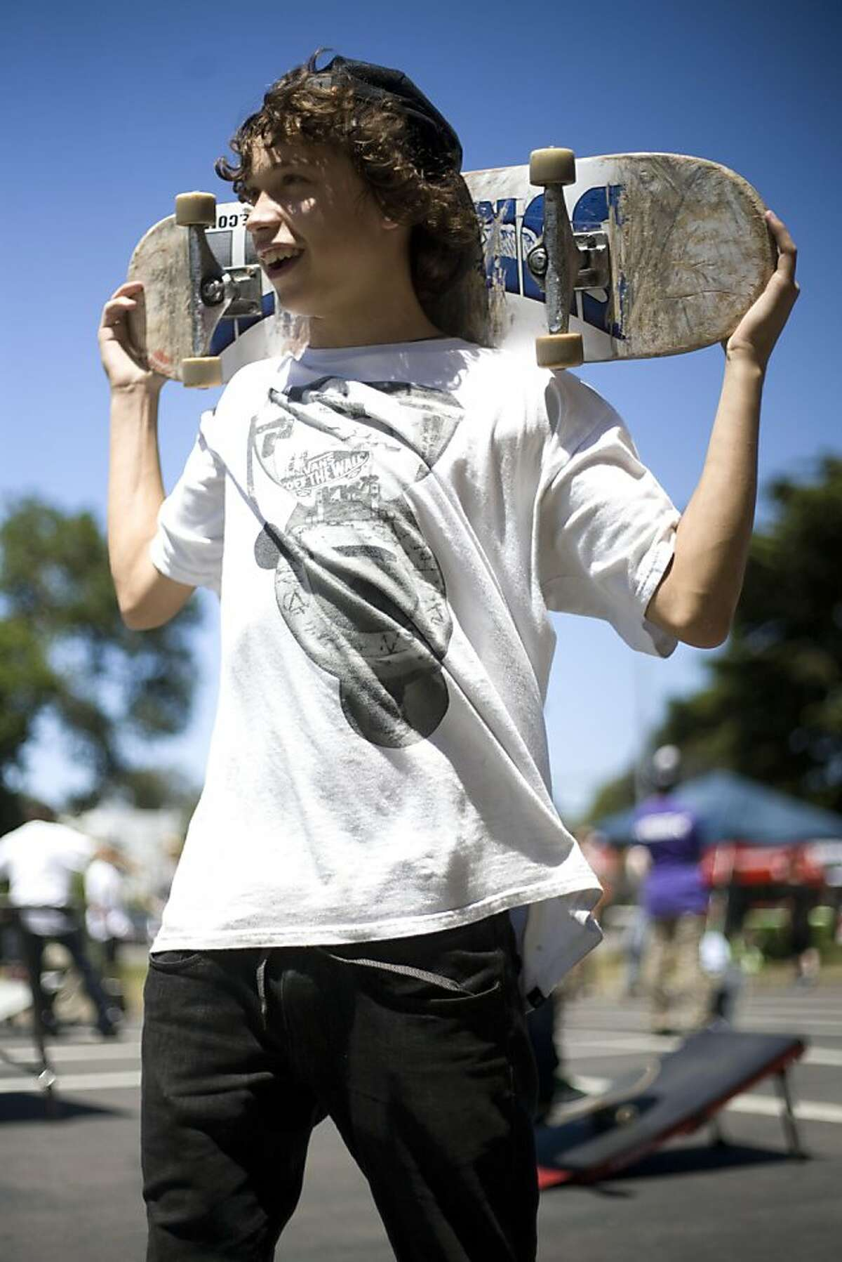 Eddie Robleto takes a break from skating at the temporary skateboard park on the closed-off stretch of Waller Street. The park opened on Tuesday, June 21. While neighbors have been fighting a skateboard park in that area for years, skateboarding advocates and city officials say the park is badly needed and will be a wholesome activity.