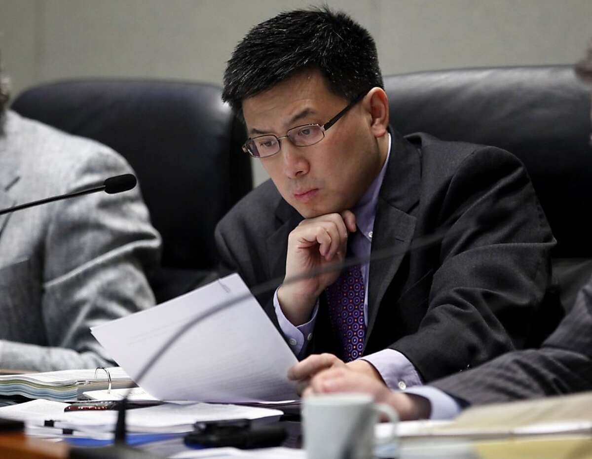File- In this March 15, 2011 file photo, California State Controller John Chiang, looks over some papers during a meeting in Sacramento, Calif. The California controller will audit the city of Montebello a struggling city for financial irregularities amid suspicions that it submitted false, incomplete or incorrect reports. Chiang announced the upcoming audit Thursday in a letter to officials in the eastern Los Angeles suburb of 65,000, which also has been the target of federal and local investigations. ( AP Photo, File)