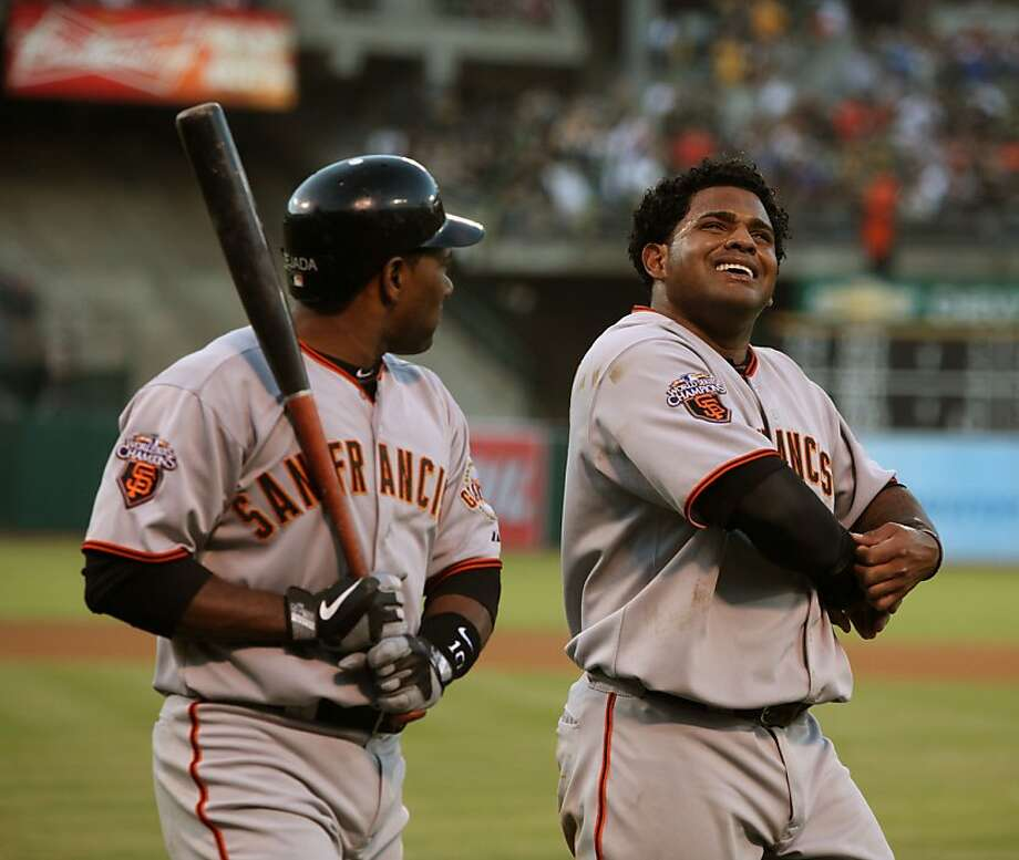 Giants third baseman Miguel Tejada (left) and first baseman Pablo Sandoval (right) during the third inning. Photo: Liz Hafalia, The Chronicle