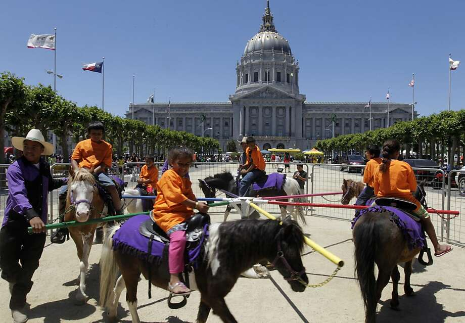 Youngsters enjoy pony rides in front of City Hall at the Summer Learning Day children's activity fair on Civic Center Plaza in San Francisco on Tuesday. Photo: Paul Chinn, The Chronicle