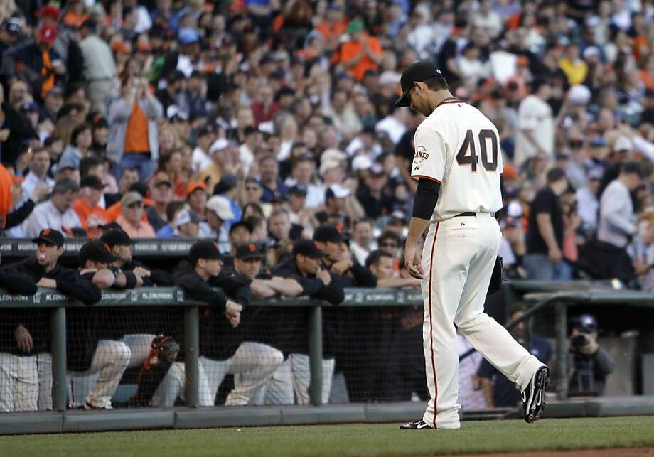 San Francisco Giants' Madison Bumgarner walks off the field after being removed from the baseball game against the Minnesota Twins during the first inning Tuesday, June 21, 2011, in San Francisco. Bumgarner allowed eight runs to score. Photo: Ben Margot, AP