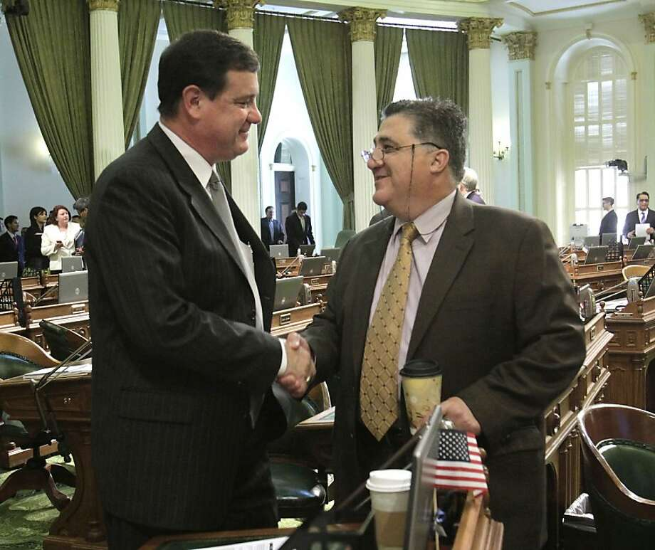 "In a move to make peace, Assemblyman Donald Wagner, R-Irvine, left, shakes hands with Assemblyman Anthony Portantino, D-La Canada, at the Capitol in Sacramento,  Calif., Thursday, June 16, 2011.  The pair exchanged words  during the budget debate Wednesday, when Portantino demanded an apology after Wagner' made a reference to Italian Americans and the cable television show  ""The Sopranos."" Photo: Rich Pedroncelli, AP"