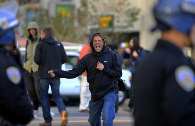 An angry protester screams at police officers after authorities cleared out the Occupy encampment at Justin Herman Plaza in an early morning raid in San Francisco, Calif. on Wednesday, Dec. 7, 2011. Photo: Paul Chinn, The Chronicle