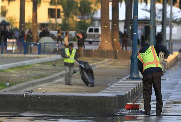 A crew from the Department of Public Works cleans up Justin Herman Plaza after police cleared out the Occupy encampment in an early morning raid in San Francisco, Calif. on Wednesday, Dec. 7, 2011. Photo: Paul Chinn, The Chronicle
