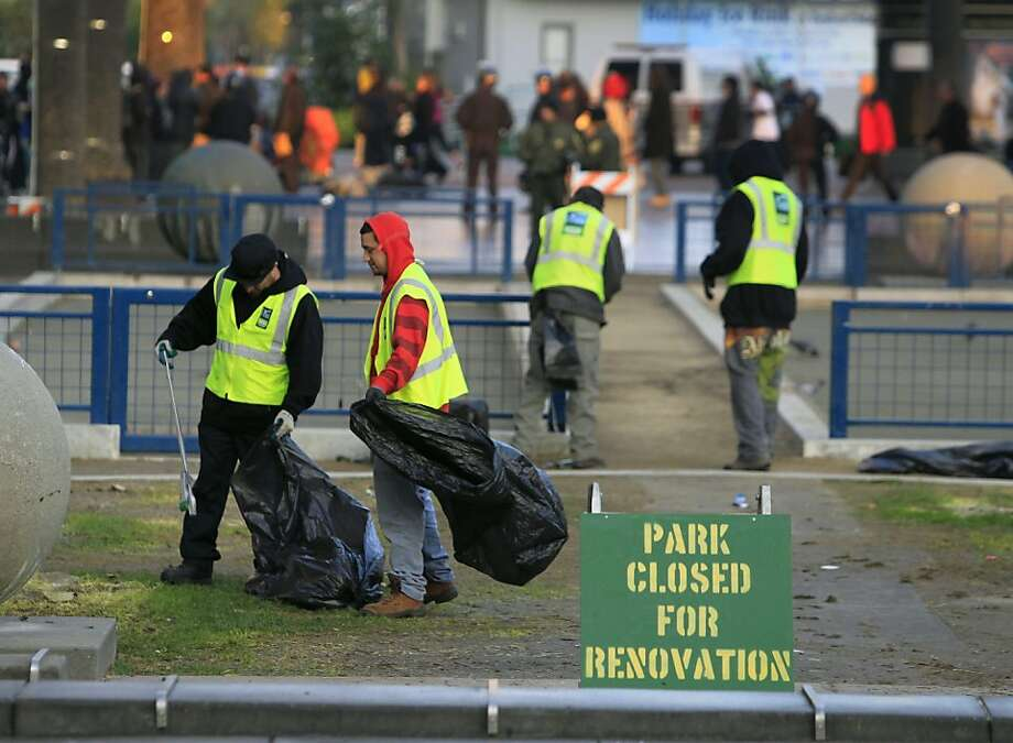 Crews from the Department of Public Works clean up Justin Herman Plaza after police cleared out the Occupy encampment in an early morning raid in San Francisco, Calif. on Wednesday, Dec. 7, 2011. Photo: Paul Chinn, The Chronicle