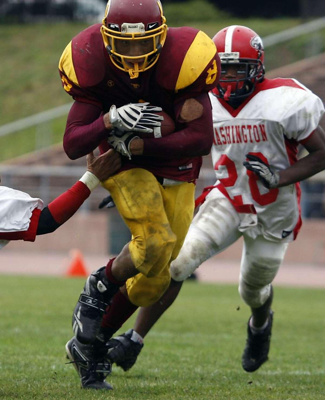 Lincoln High's Deshon Marman breaks free to score a 4th quarter touchdown.