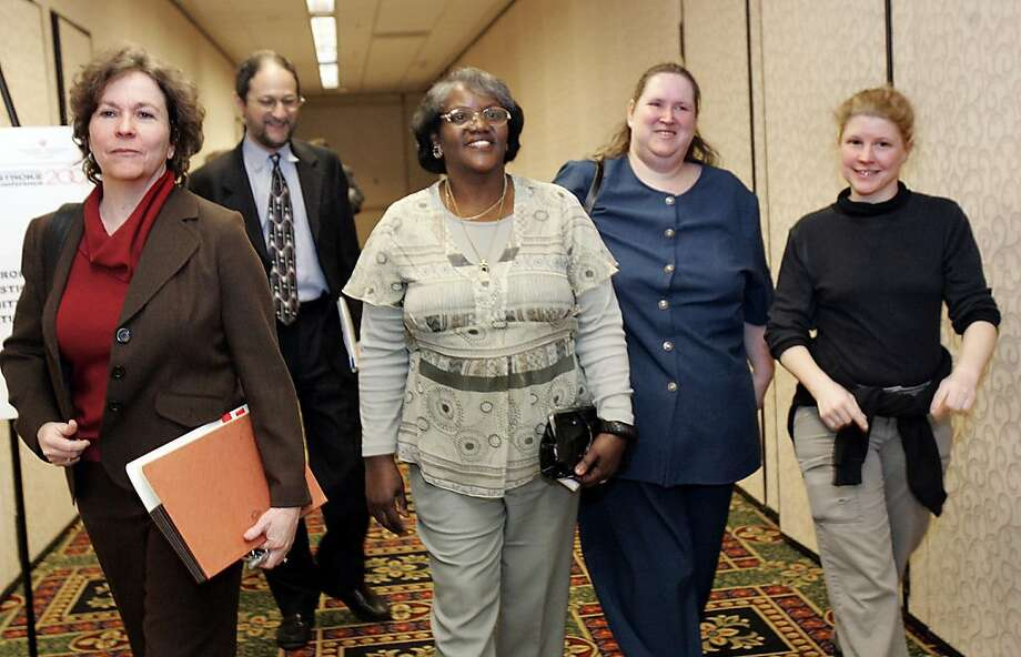 Plaintiffs' counsel Elizabeth Lawrence (left), head counsel Brad Seligman and plaintiffs Betty Dukes, Patricia Surgeson and Christine Kwapnoski leave a 2007 news conference together. Photo: Katy Raddatz, The Chronicle