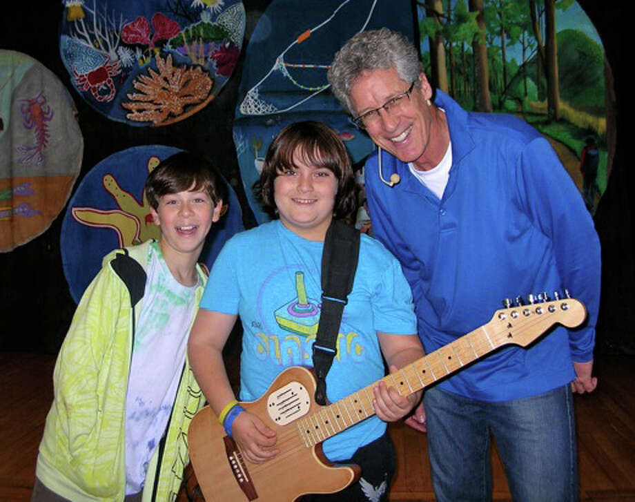 Mr. B shares his guitar with Josiah Harris and Lantz Riggio. Photo: Contributed Photo