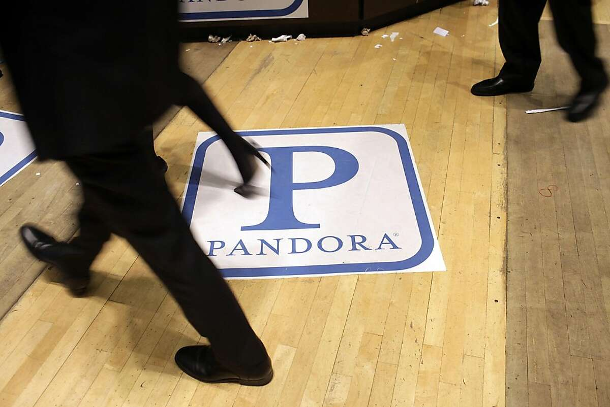 NEW YORK, NY - JUNE 15: Traders on the floor of the New York Stock Exchange walk over insignia for Pandora Media Inc., the online-radio company, on its first day of trading as a public company on June 15, 2011 in New York City. Pandora stock rose as muchas 63 percent to $26 following its debut on the New York Stock Exchange, under the symbol P. Reversing much of the previous day's gains, stocks fell Wednesday as more news emerged about the fragility of the American and global economy. The Dow Jones Industrial Average fell 88 points, or 0.8%, to 11987 in morning trading.
