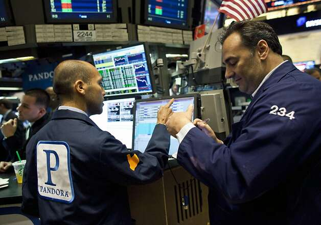 A trader wearing a Pandora Media Inc. jacket, left, works on the floor of the New York Stock Exchange in New York, U.S., on Wednesday, June 15, 2011. Pandora Media Inc., the online-radio company, surged after its shares priced above the top of range, giving investors a chance to benefit from the limited number of new Internet stocks. Photo: Ramin Talaie, Bloomberg