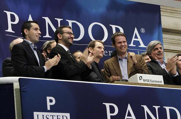 Joe Kennedy, third from left, CEO & President, and Tim Westergren, fourth from left, Chief Strategy Officer & Founder, of Pandora internet radio, ring the NYSE opening bell to celebrate their company's IPO at the New York Stock Exchange Wednesday, June 15, 2011. Photo: Richard Drew, AP