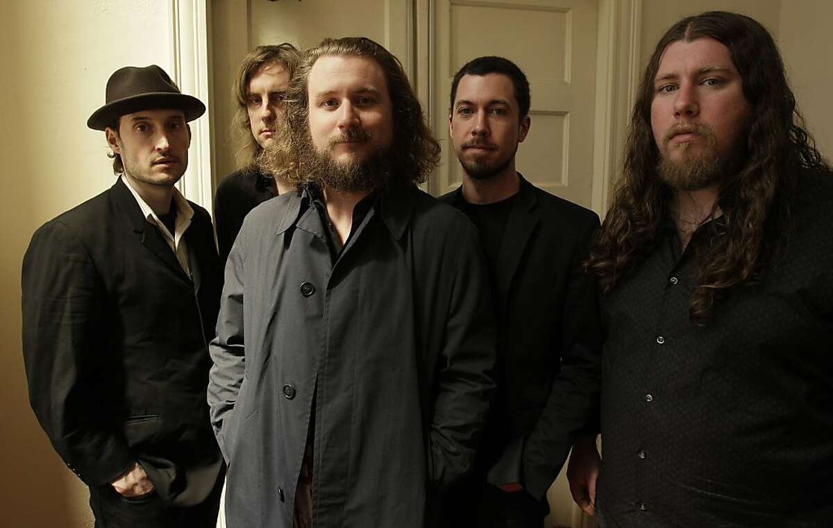 """In this Wednesday, April 13, 2011 photo, members of My Morning Jacket, from left, Bo Koster, Carl Broemel, Jim James, Tom Blankenship and Patrick Hallahan pose for a photograph in Louisville, Ky. James says the the Kentucky quintet's much-anticipated newalbum, """"Circuital,"""" reflects a search he's been on for some time."""