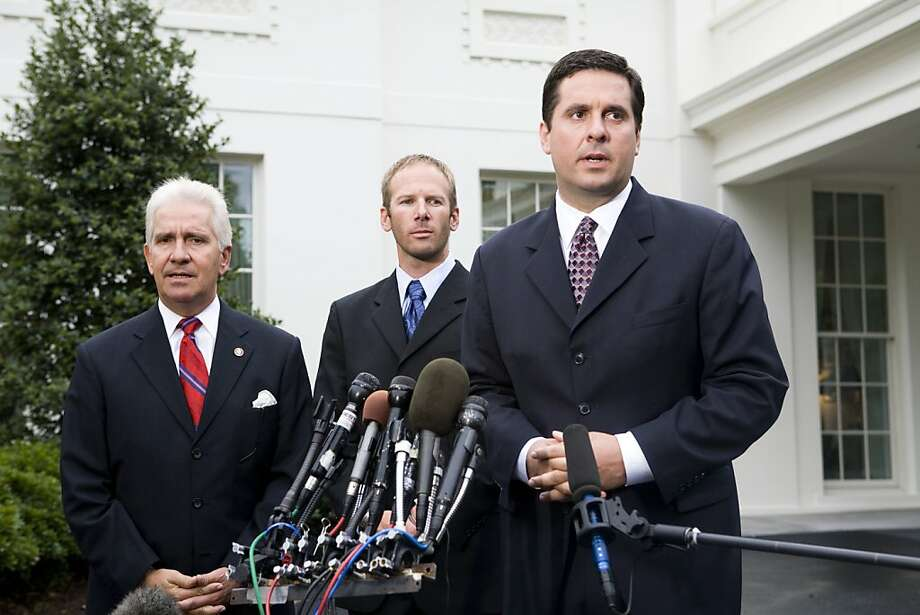 WASHINGTON - AUGUST 29: Rep. Devin Nunes (R-CA) right ,Jason Hubbard (C), and Rep. Jim Costa (R-CA) speak with the media after attending the signing by President George W. Bush of the Hubbard Act into law August 29, 2008 in Washington, DC. The Hubbard Act, named for Jason Hubbard, who lost two brothers in Iraq, allows sole survivors who leave a war zone to receive the same military benefits as other combat veterans. (Photo by Brendan Hoffman/Getty Images) Photo: Brendan Hoffman, Getty Images