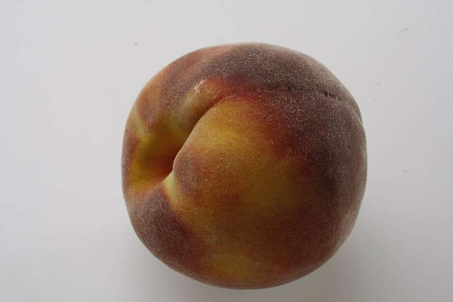 Peaches are arriving later this year due to a wet spring. Photo: Eric Luse, SFC