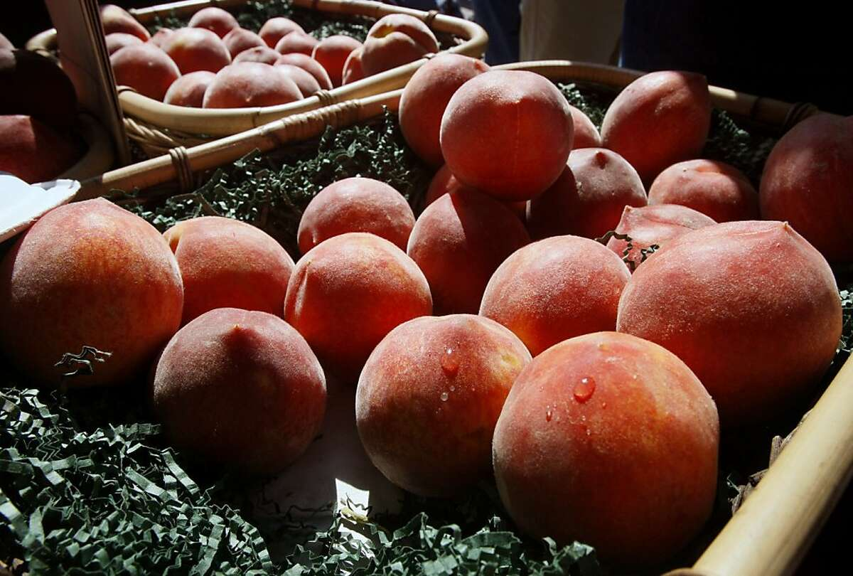 Peaches glow in the morning sunlight at the Ferry Plaza Farmers Market.