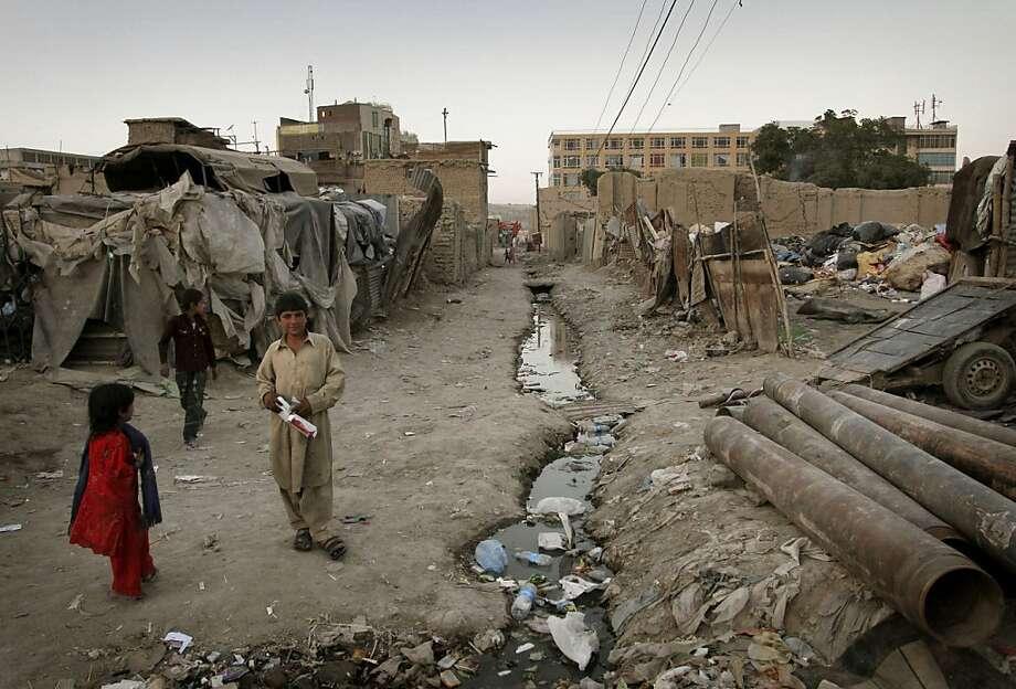 Afghan children are seen in a poor neighborhood of Kabul, Afghanistan, Monday, June 6, 2011. (AP Photo/Musadeq Sadeq) Photo: Musadeq Sadeq, Associated Press