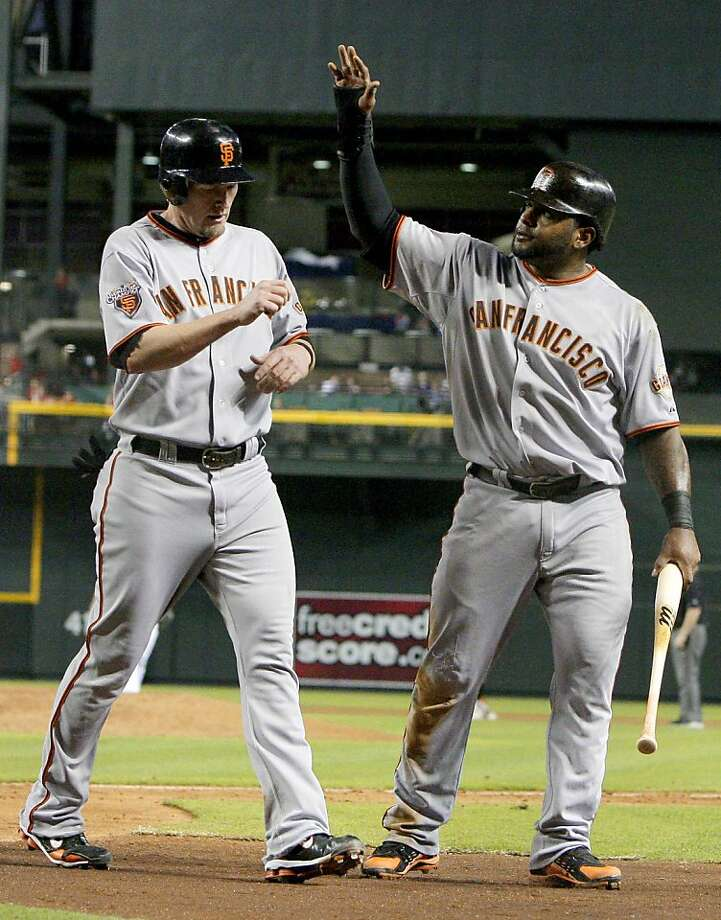 San Francisco Giants' Pablo Sandoval, right, and Aubrey Huff celebrate their runs against the Arizona Diamondbacks during the fifth inning of a baseball game Tuesday, June 14, 2011, in Phoenix. Photo: Ross D. Franklin, AP
