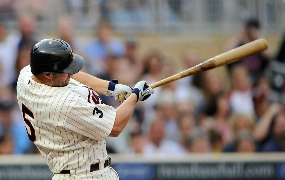 MINNEAPOLIS, MN - JUNE 17: Michael Cuddyer #5 of the Minnesota Twins gets an RBI double against the San Diego Padres in the first inning on June 17, 2011 at Target Field in Minneapolis, Minnesota. Photo: Hannah Foslien, Getty Images