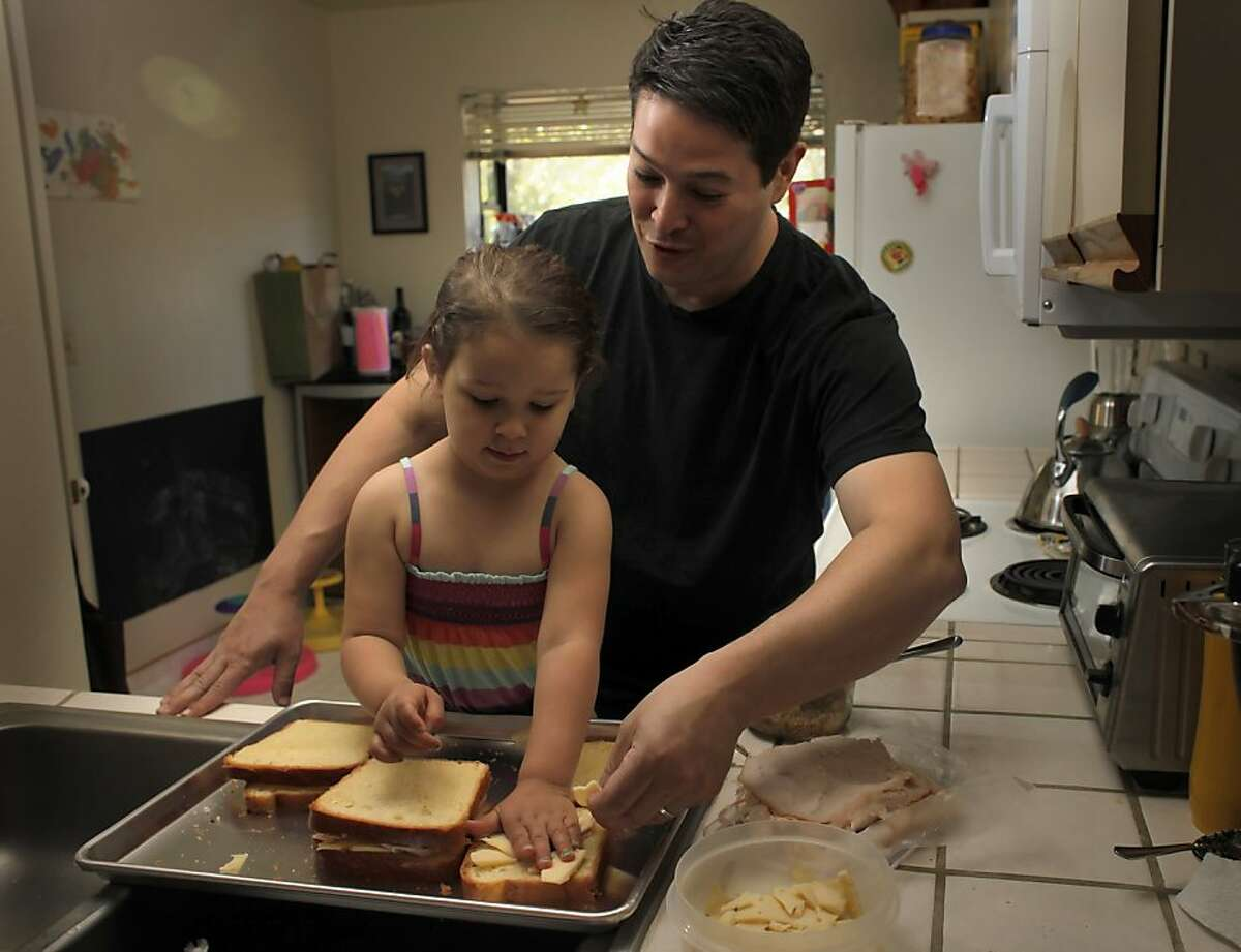 Jason Fox, chef of Commonwealth restaurant makes a grilled cheese sandwich with his daughter Lily at their home in Mill Valley.