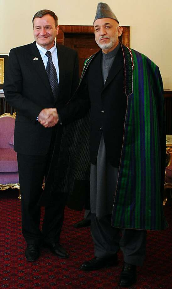 "RESTRICTED TO EDITORIAL USE GETTY OUT  (FILES) In this handout photograph taken on May 12, 2009, Afghanistan's President Hamid Karzai (R) shakes hands with US Ambassador to Afghanistan Karl W. Eikenberry (L) at The Presidential Palace in Kabul.  Afghan government officials on December 3, 2010, has hit back at ""stupid"" allegations made in leaked US diplomatic cables about corruption but refused to comment on a damning assessment of President Hamid Karzai. Deputy presidential spokesman Hamed Elmi downplayeddocuments released by Internet whistleblower WikiLeaks as ""not much new,"" with ""nothing substantive to negatively affect our good relations with the international community"".  In one cable, US envoy Karl Eikenberry portrayed Karzai as ""paranoid and wea Photo: Ho, AFP/Getty Images"