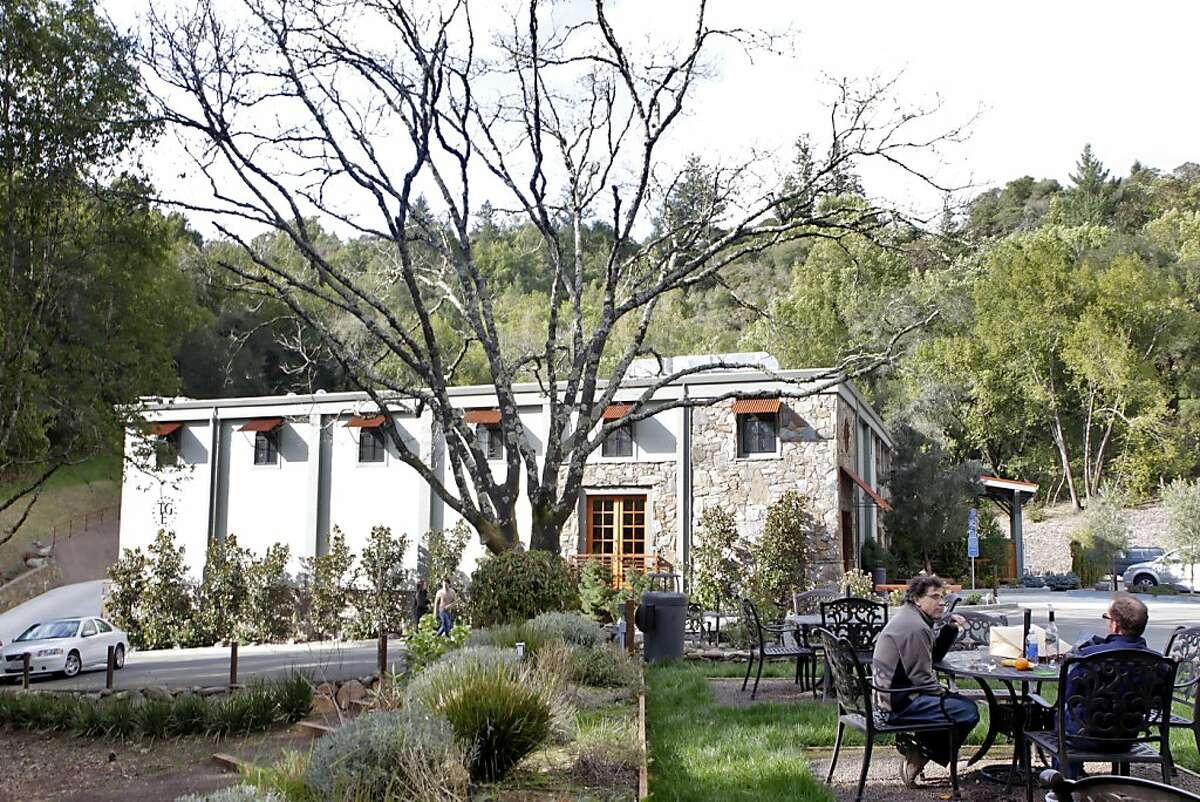 Customers enjoy the lush gardens at the Thomas George Estates tasting room, Tuesday March 1, 2011, in Healdsburg, Calif.