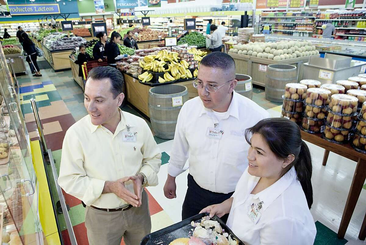 From left, CEO and founder, Juvenal Chavez Sr., Northern District Manager, Robert Esquivel and Teritory Panderia (Bakery) Director, Dalia Pelayo discuss the specifics of size and shape of bakery products in the Panderia (bakery) at Mi Pueblo Food Center in Hayward, Calif. on Friday, June 3, 2011. Celebrating their 20th anniversary this year the stores were started by CEO Juvenal Chavez Sr. and his wife, Mexican immigrants who wanted to help preserve their culture and provide other imigrants with the foods and customs of his homeland.