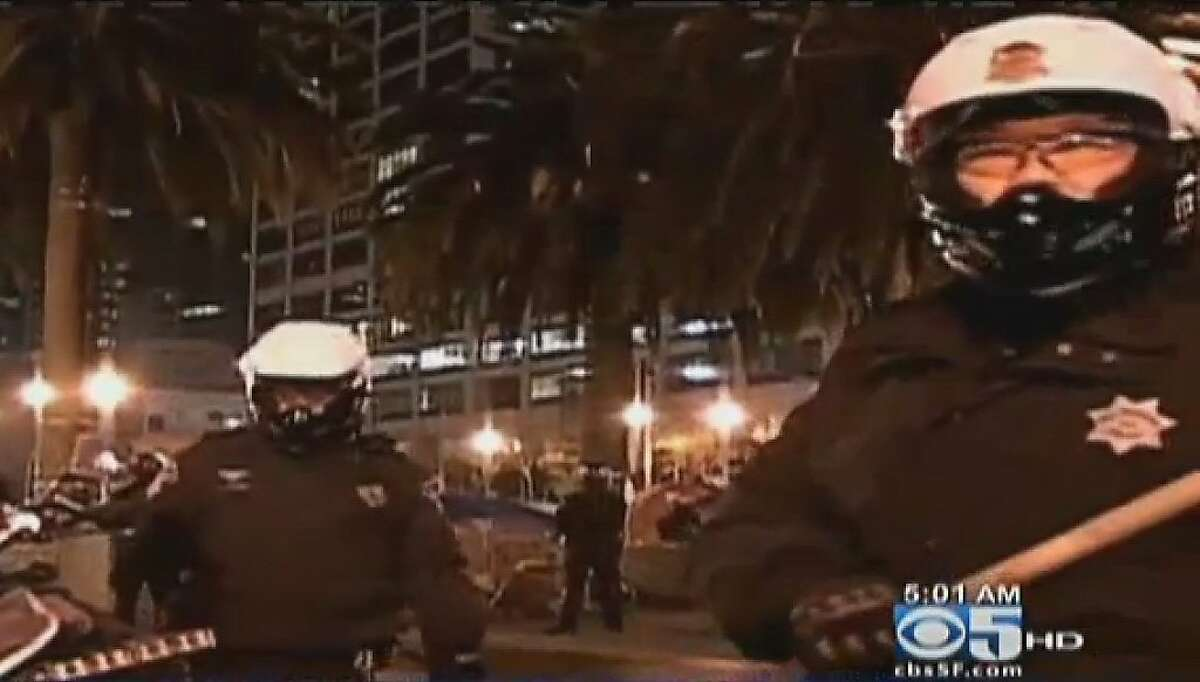 San Francisco Police dismantle the 2-month old Occupy SF encampment early this morning in Justin Herman Plaza.