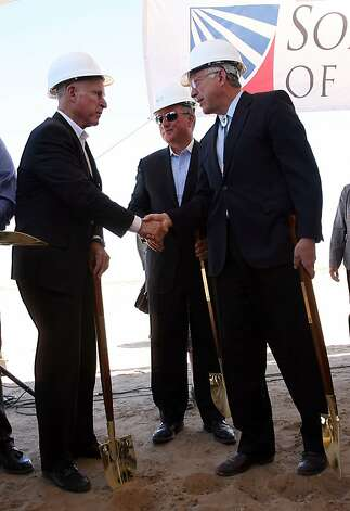 California Gov. Jerry Brown, left, shakes hands with U.S. Secretary of the Interior Ken Salazar, right, as Solar Trust of America Chairman and CEO Uwe T. Schmidt looks on Friday, June 17, 2011, during a groundbreaking event near Blythe, Calif., for the Blythe Solar Power Project. The project is being built eight miles west of Blythe by Solar Trust of America. (AP Photo/The Desert Sun, Crystal Chatham) RIVERSIDE PRESS-ENTERPRISE OUT; NO FOREIGN Photo: Crystal Chatham, Associated Press