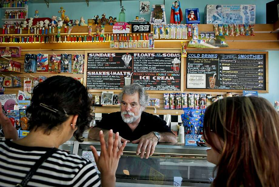 Jesse Fink, owner of Toy Boat, an ice cream/toy shop in the Richmond district that he's run for 28 years, helps customers on Wednesday, June 8, 2011 in San Francisco, Calif. Photo: Russell Yip, The Chronicle