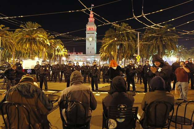 TOPSHOTS San Francisco Police officers surround the Occupy San Francisco encampment at Justin Herman Plaza to clear the camp on December 7, 2011 in California.    AFP PHOTO / Kimihiro Hoshino (Photo credit should read KIMIHIRO HOSHINO/AFP/Getty Images) Photo: Kimihiro Hoshino, AFP/Getty Images