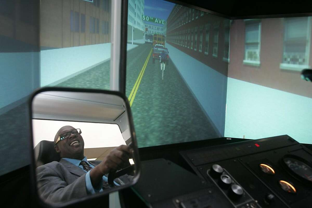 Training instructor Ron Jordon operates a bus simulator at SamTrans' north base on Thursday, June 16, 2011 in South San Francisco, Calif. The San Mateo County bus service hosted a tour of its facilities in recognition of National Dump the Pump Day to encourage people to use public transportation instead of their cars.