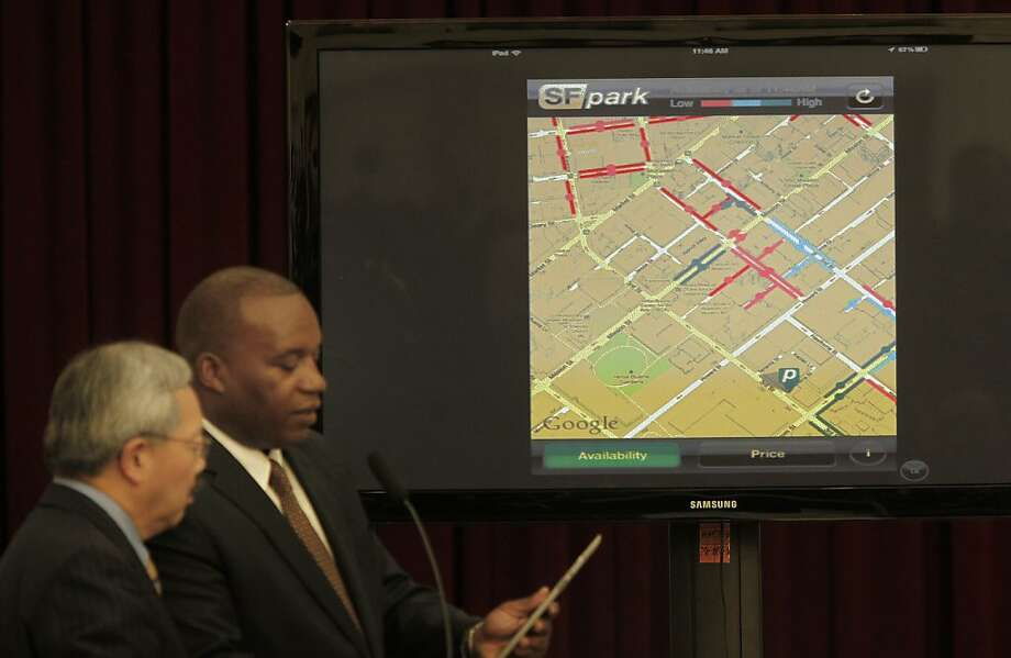 San Francisco Mayor Edwin Lee (left) and SFMTA director Nathaniel Ford showed the SFpark website on a screen.  The red areas of downtown indicate no parking areas, the blue areas indicate parking available. The city of San Francisco launched the SFpark system which includes a smart-phone and computer application that shows available parking in major retail, and tourist areas in the city Thursday April 21, 2011. Photo: Brant Ward, The Chronicle