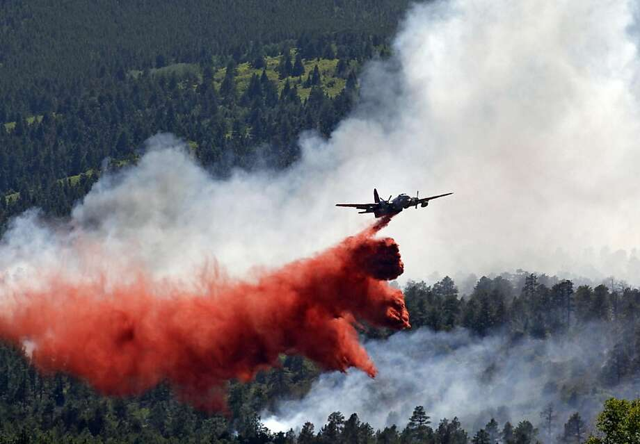 A slurry bomber drops a load of fire retardant on the leading edge of the Duckett wildfire north of Westcliffe, Colo., on Thursday, June 16, 2011.  The fire has burned over 2,900 acres since it started on Sunday. Photo: Ed Andrieski, AP