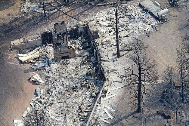 A burnt structure is shown following the track fire north of Raton, N.M., Thursday, June 16, 2011, as seen from a KOAT-TV helicopter. Photo: Rick Bowmer, AP