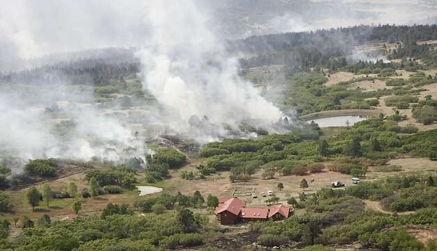 Smoke billows from the track forest fire near a home north of Raton, N.M., Thursday, June 16, 2011, as seen from a KOAT-TV helicopter. Photo: Rick Bowmer, AP