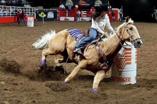 Brittany Pozzi of Victoria competes in the barrel racing event at the 2011 San Antonio Stock Show & Rodeo.