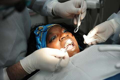 Free dental care gives uninsured a reason to smile - SFGate