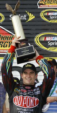 Jeff Gordon poses with the trophy in victory lane after winning the NASCAR Sprint Cup Series auto race, Sunday, June 12, 2011, in Long Pond, Pa. Photo: Russ Hamilton Sr., AP