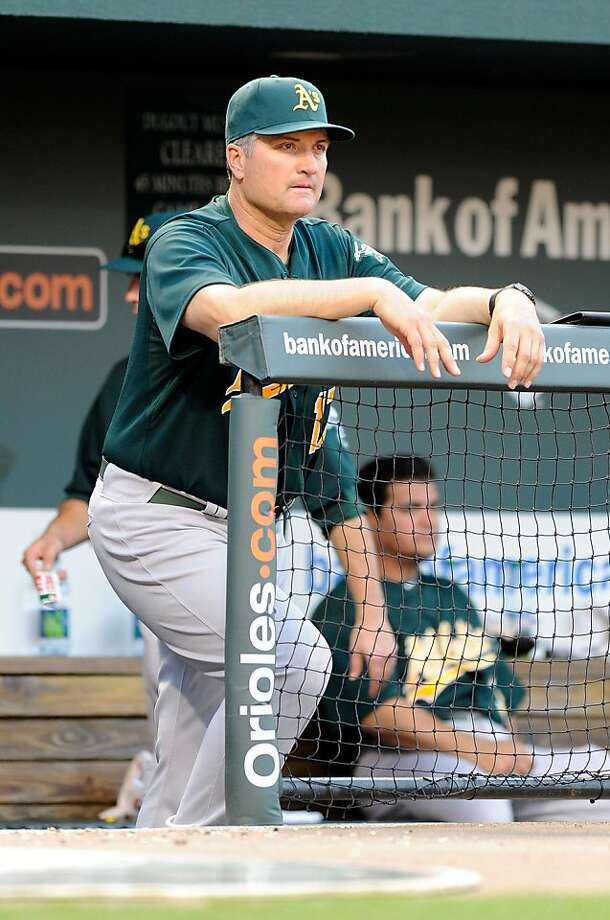 BALTIMORE, MD - FILE: Manager Bob Geren #17 of the Oakland Athletics watches the game against the Baltimore Orioles at Oriole Park at Camden Yards on June 6, 2011 in Baltimore, Maryland. According to reports on June 9, 2011, Geren was fired as manager ofthe A's and will be replaced by Bob Melvin who will be the interim manager. Photo: Greg Fiume, Getty Images
