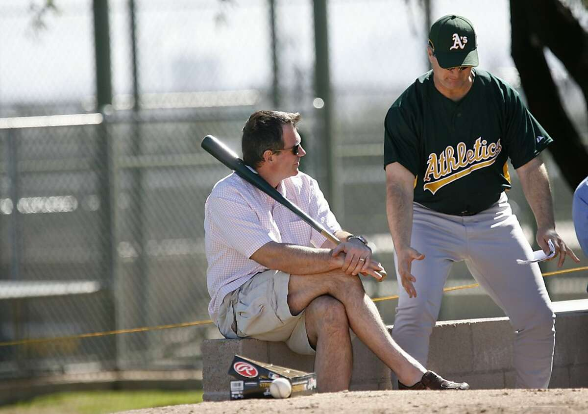 Athletics General Manager, Billy Beane, at left, listens as his new manager, Bob Geren tells him a story. The Oakland Athletics pitchers and catchers have their first workout of Spring Training at Papago Park. Photographed in Phoenix on 2/17/07. Chronicle Photo / Deanne Fitzmaurice